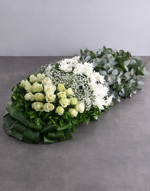 Green and White Funeral Coffin Display