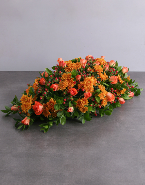 Orange Sprays and Roses Funeral Coffin Display