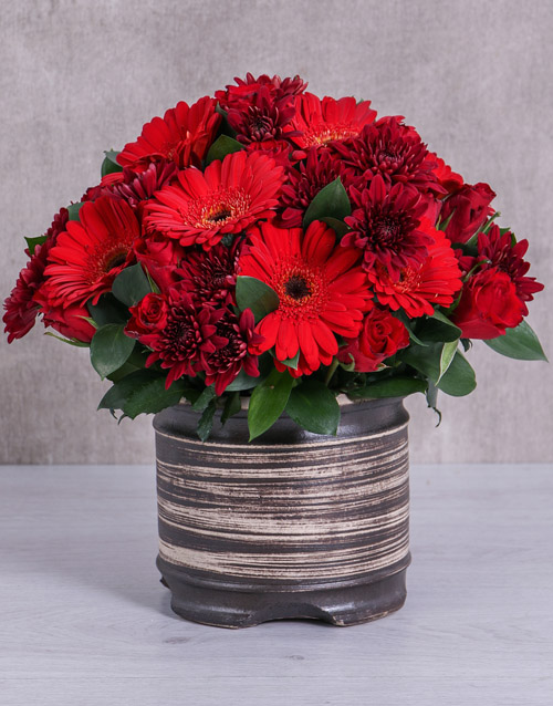 Mixed Red Flowers In Ceramic Pot