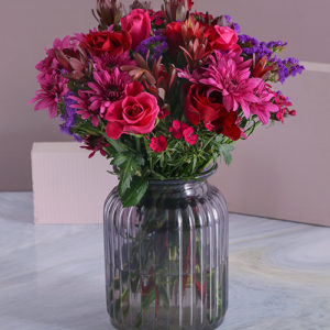 Red and Cerise Blooms in a Vase