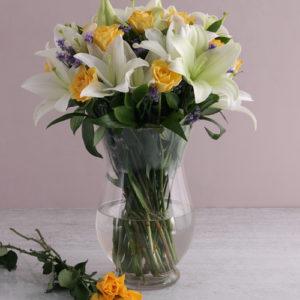 Floral Elegance In A Hurricane Vase