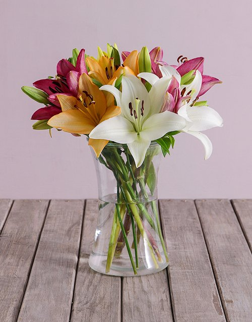Lush Lilies In A Clear Vase