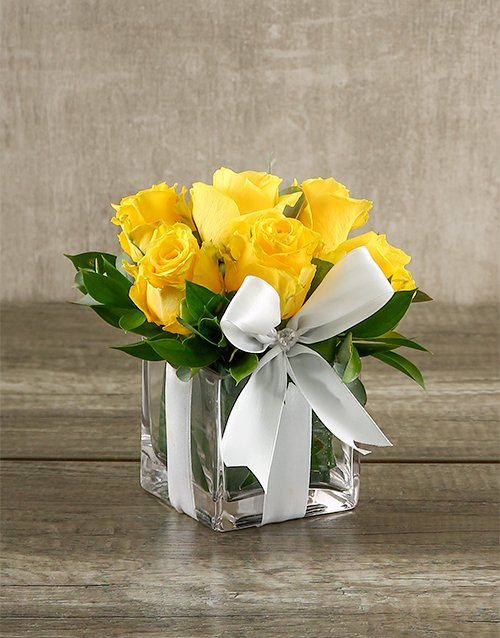 roses Yellow Roses in a Small Square Vase