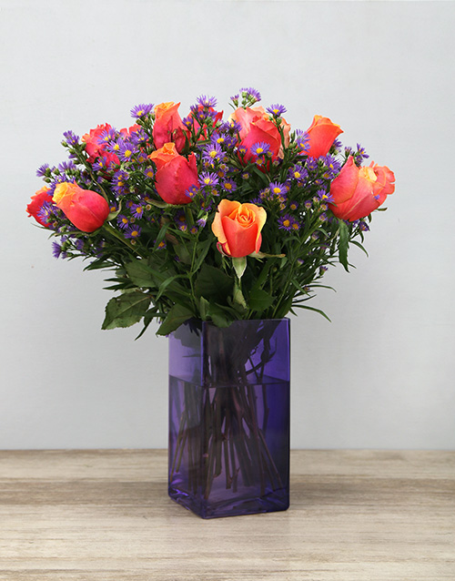 roses Cherry Brandy Roses in Purple Vase