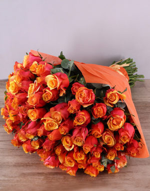 roses Cherry Brandy Roses In Orange Wrapping