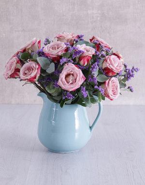 roses Variegated Roses in Ceramic Water Jug