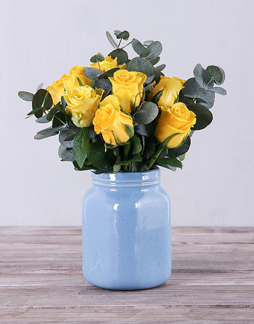 roses Yellow Roses in Blue Vase