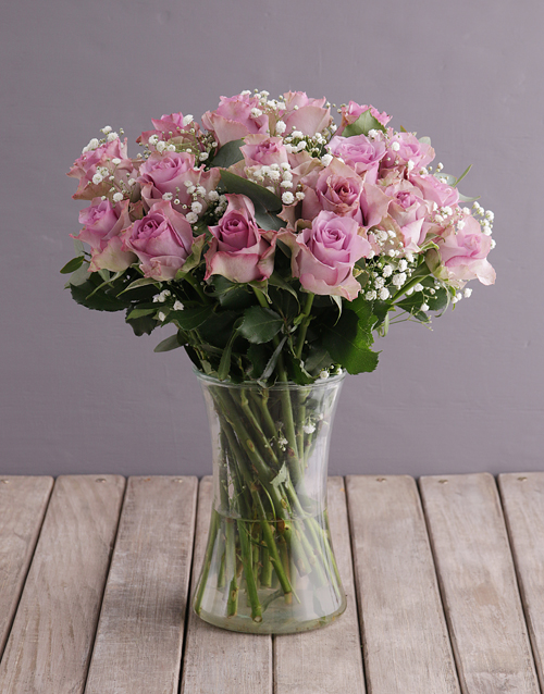 roses Lush Lilac Roses in Glass Vase