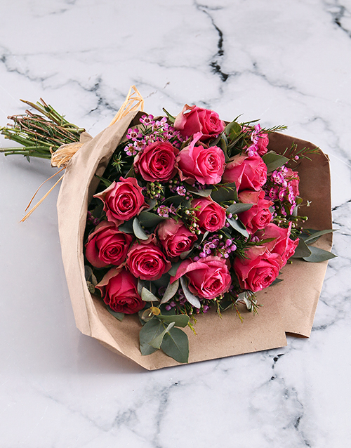 roses Cerise Roses In Brown Paper Wrapping