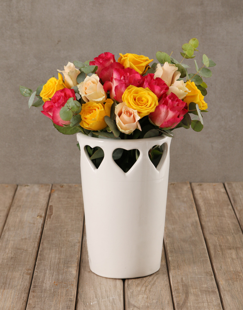 roses Vibrant Blooms in Cut Out Heart Vase